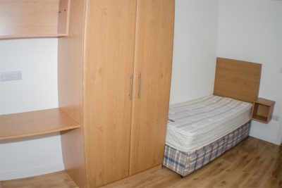 Thomond Village single bed bed room